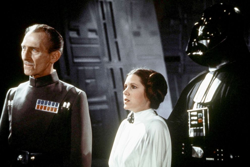 PHOTO: Peter Cushing, left, Carrie Fisher and David Prowse on the set of Star Wars: Episode IV - A New Hope.