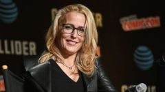 'PHOTO:Gillian Anderson speaks onstage1_b@b_1The X-Files panel during 2017 New York Comic Con, Oct. 8, 2017, in New York.' from the web at 'http://a.abcnews.com/images/Entertainment/gillian-anderson-gty-ml-180111_16x9t_240.jpg'