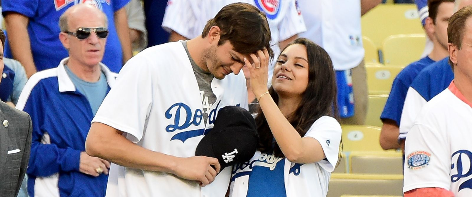 PHOTO: Ashton Kutcher and Mila Kunis on the field after they announced the Los Angeles Dodgers starting lineup before game four of the National League Championship Series, Oct. 19, 2016, in Los Angeles.