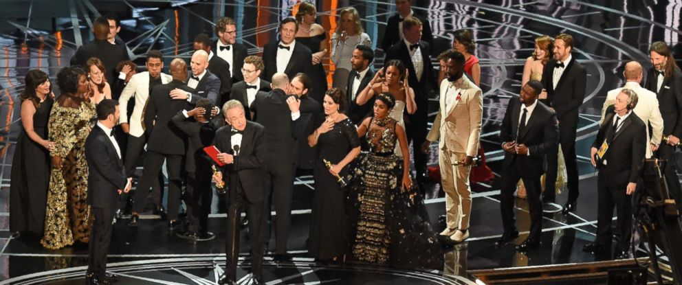 "PHOTO: The cast of ""Moonlight"" and """"La La Land"" appear on stage as presenter Warren Beatty shows the winners envelope at the 89th Oscars on Feb. 26, 2017 in Hollywood, Calif."