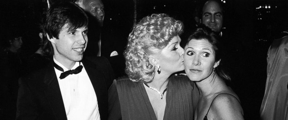 PHOTO: Debbie Reynolds (C) with children Todd (L) and Carrie Fisher (R) at the Thalians Ball, Oct. 12, 1985.