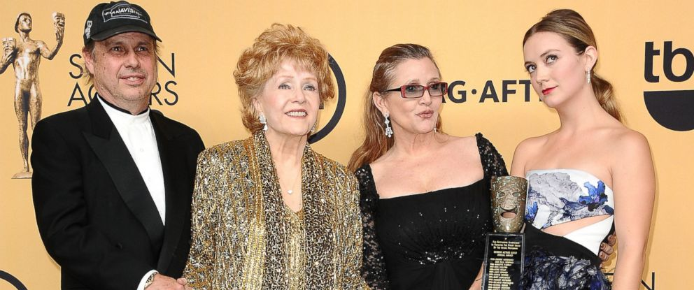 PHOTO: Todd Fisher, Debbie Reynolds, Carrie Fisher and Billie Lourd pose in the press room at the 21st annual Screen Actors Guild Awards at The Shrine Auditorium, Jan. 25, 2015, in Los Angeles.