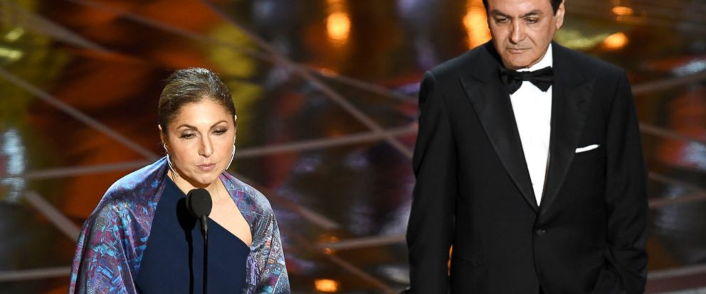 PHOTO: Engineer/astronaut Anousheh Ansari (L) and former NASA scientist Firouz Naderi accept Best Foreign Language Film for The Salesman on behalf of director Asghar Farhadi during the 89th Annual Academy Awards, Feb. 26, 2017, in Hollywood, Calif.
