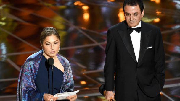 PHOTO: Engineer/astronaut Anousheh Ansari (L) and former NASA scientist Firouz Naderi accept Best Foreign Language Film for 'The Salesman' on behalf of director Asghar Farhadi during the 89th Annual Academy Awards, Feb. 26, 2017, in Hollywood, Calif.