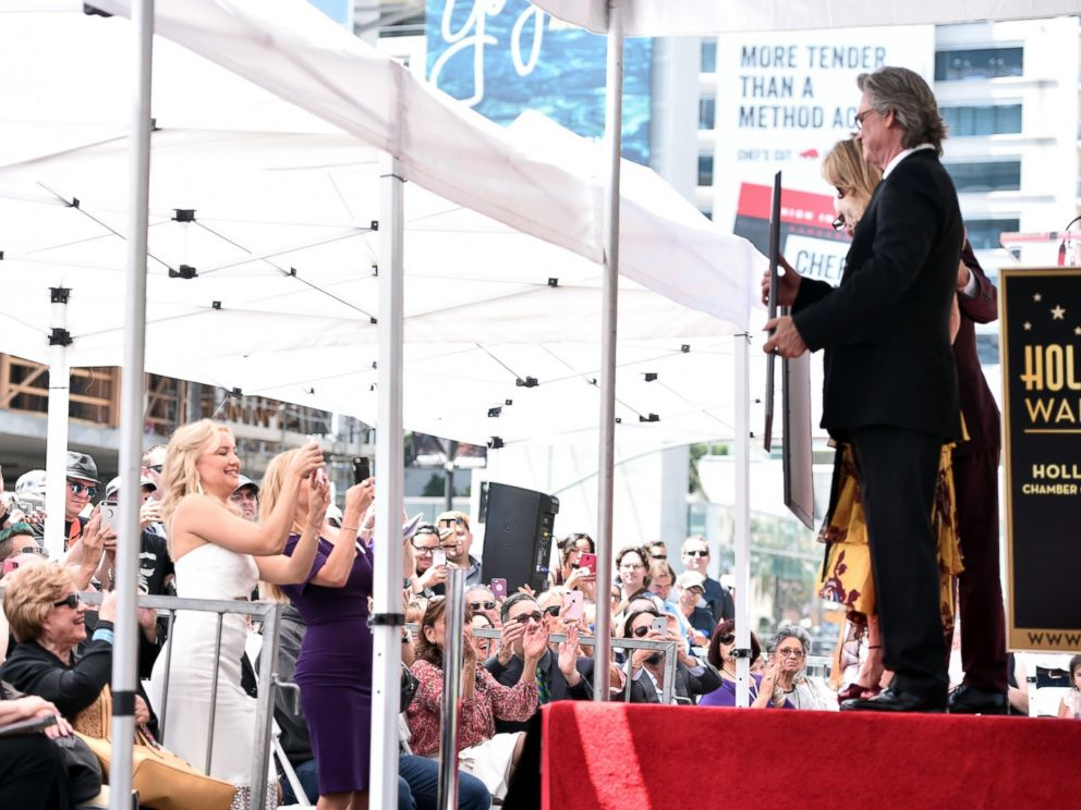 PHOTO: Kate Hudson and Reese Witherspoon take photos in the crowd as Kurt Russell and Goldie Hawn are honored with a double star ceremony on the Hollywood Walk of Fame, May 4, 2017, in Hollywood, California.