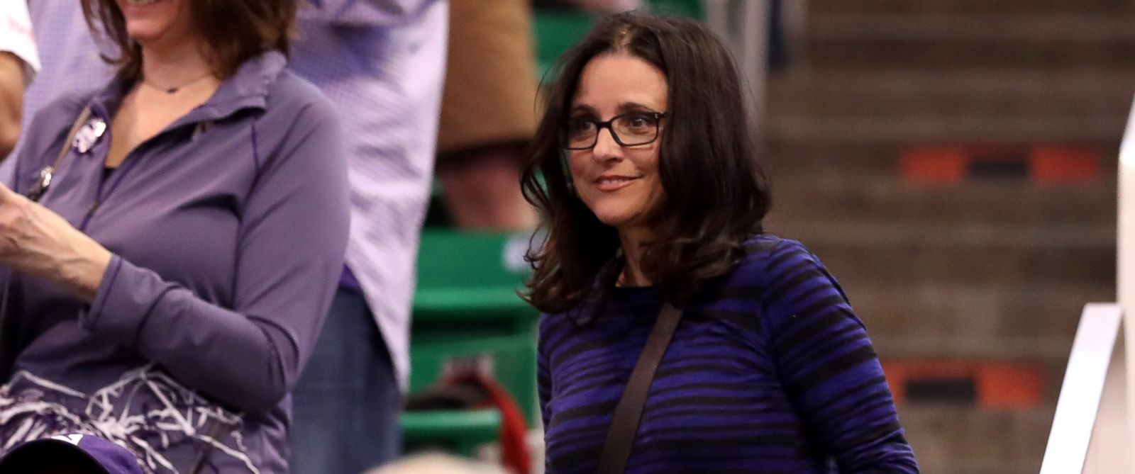PHOTO: Julia Louis-Dreyfus looks on as the Northwestern Wildcats play the Vanderbilt Commodores during the first round of the 2017 NCAA Mens Basketball Tournament at Vivint Smart Home Arena, March 16, 2017, in Salt Lake City, Utah.