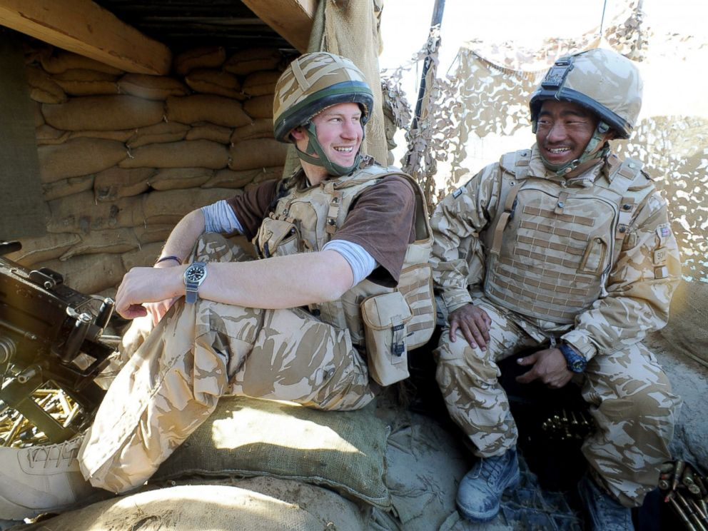 PHOTO: Prince Harry talks to a Gurkha soldier after firing a 50mm machine gun at Taliban fighters from the observation post in Helmand province, Southern Afghanistan, Jan. 2, 2008.