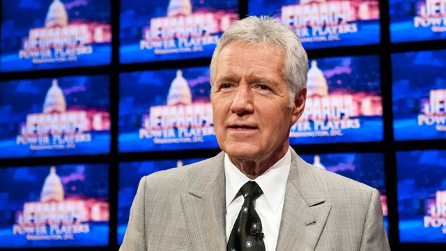 PHOTO: Alex Trebek speaks during a rehearsal before a taping of  Jeopardy! Power Players Week at DAR Constitution Hall on April 21, 2012 in Washington, DC.