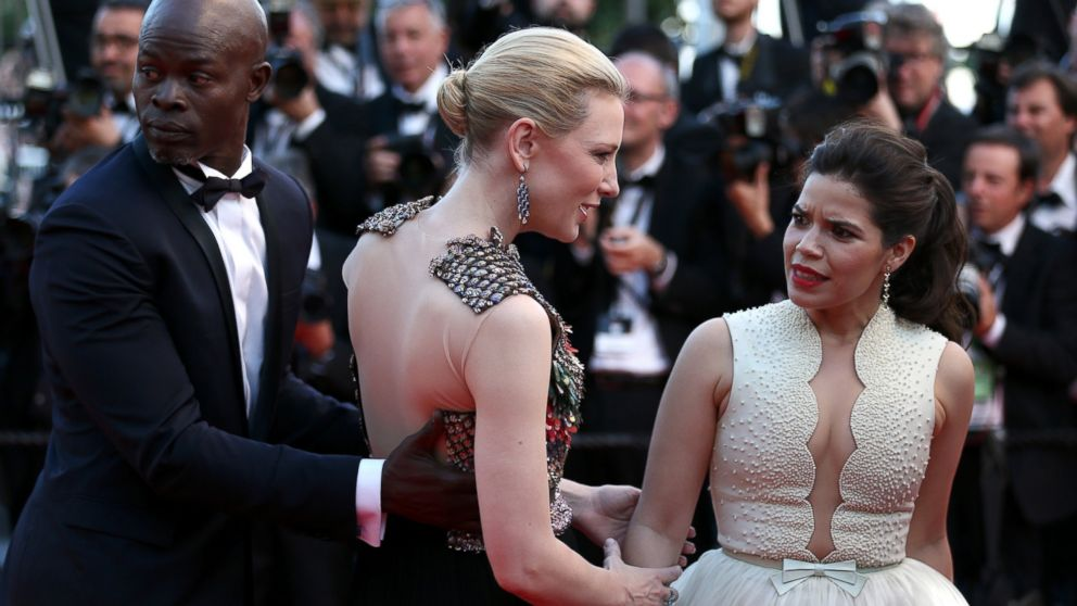 "PHOTO: America Ferrera reacts after a man attempted to climb under her dress on the red carpet at the ""How To Train Your Dragon 2"" premiere during the Cannes Film Festival on May 16, 2014 in Cannes, France."