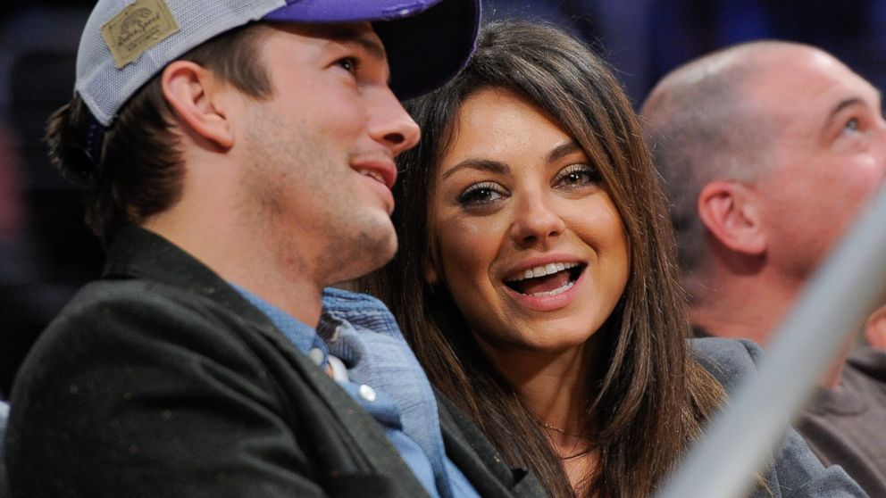 PHOTO: Ashton Kutcher and Mila Kunis attend a basketball game between the Utah Jazz and the Los Angeles Lakers at Staples Center on Jan. 3, 2014 in Los Angeles, Calif.