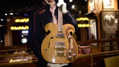 PHOTO: A rare Vox guitar played by Beatles John Lennon and George Harrison is presented by Julien's Auctions, May 13, 2013.