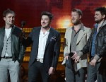 PHOTO: Winners for Best Album of the Year, the Mumford & Sons, reacts on stage at the Staples Center during the 55th Grammy Awards in Los Angeles, Feb. 10, 2013.