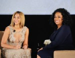 "PHOTO: Beyonce and Oprah Winfrey speak onstage at the HBO Documentary Film ""Beyonce: Life Is But A Dream"" New York Premiere at the Ziegfeld Theater on February 12, 2013 in New York City."