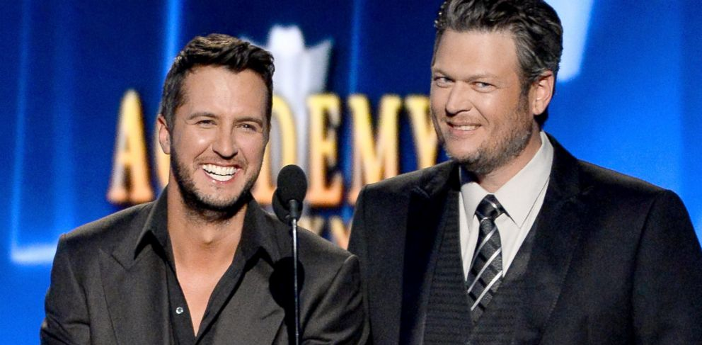 PHOTO: Luke Bryan and Blake Shelton speak onstage during the 49th Annual Academy of Country Music Awards on April 6, 2014 in Las Vegas.