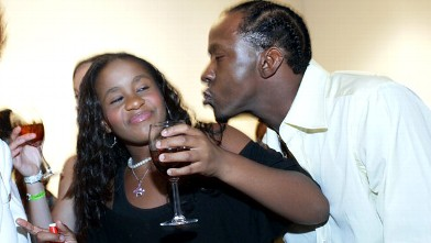 PHOTO: Bobbi Kristina and her dad Bobby Brown play around at the premiere of the new show &quot;Being Bobby Brown&quot; on June 27, 2005 in Atlanta, Georgia.