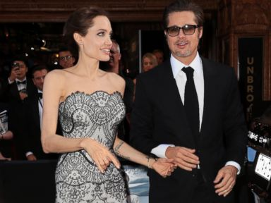 PHOTO: Angelina Jolie and Brad Pitt walk the red carpet at the Unbroken world premiere in Sydney, Nov. 17, 2014.
