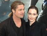 PHOTO: Brad Pitt and Angelina Jolie attend the World War Z Paris premiere at Cinema UGC Normandie on June 3, 2013 in Paris.