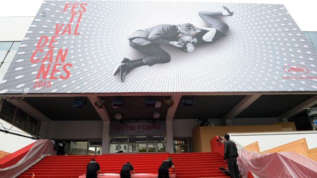 PHOTO: Workers roll out the red carpet before the 66th Annual Cannes Film Festival at Palais des Festivals on May 15, 2013 in Cannes, France.