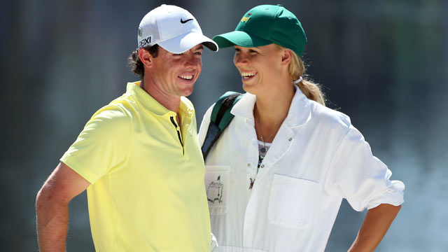 PHOTO: Rory McIlroy, of Northern Ireland, stands with his caddie Caroline Wozniacki during the 2013 Masters Tournament at Augusta National Golf Club, April 10, 2013, in Augusta, Georgia.