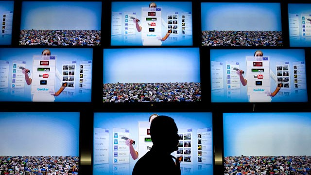 PHOTO: An attendee passes LG Electronics Inc. Smart TV displays during the 2011 International Consumer Electronics Show (CES) in Las Vegas, Nevada,  Jan. 7, 2011.