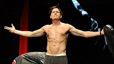 "PHOTO: Charlie Sheen speaks on stage during his ""Violent Torpedo of Truth/Defeat Is Not An Option"" tour at Radio City Music Hall on April 10, 2011 in New York City."