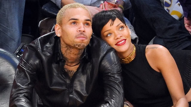 PHOTO: Chris Brown, left, and Rihanna attend a basketball game between the New York Knicks and the Los Angeles Lakers at Staples Center, Dec. 25, 2012 in Los Angeles, CA.