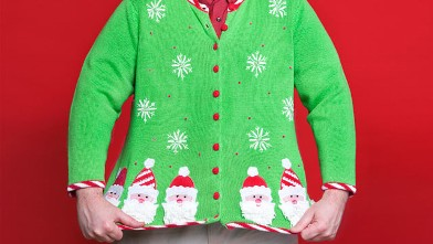 A man showing his Christmas sweater.