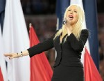 PHOTO: Singer Christina Aguilera sings the National Anthem during Super Bowl XLV between the Pittsburgh Steelers and the Green Bay Packers at Cowboys Stadium, Feb. 6, 2011 in Arlington, Texas.