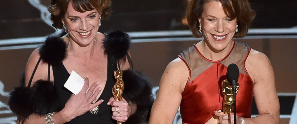 "PHOTO: Producer Dana Perry and director Ellen Goosenberg Kent accept the Best Documentary Short Award for ""Crisis Hotline; Veterans Press 1"" onstage during the 87th Annual Academy Awards on Feb. 22, 2015 in Hollywood, California."