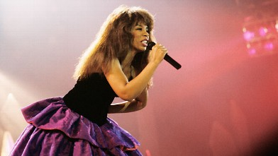 PHOTO: Photo of Donna Summer performing on stage.