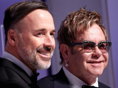 PHOTO: Sir Elton John and his partner David Furnish arrive at the 18th Annual HRC National Dinner at The Walter E. Washington Convention Center on Oct. 25, 2014 in Washington, DC.