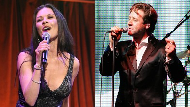PHOTO: Catherine Zeta-Jones, left, performs when she attends the 2012 Windward School benefit at Cipriani 42nd Street on April 21, 2012 in New York City while actor Russell Crowe, right, sings with his new band The Ordinary Fear of God during  the L'Oreal