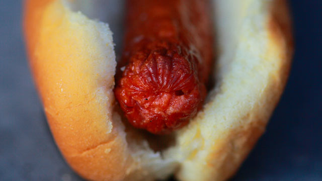 PHOTO: The Feasty Boys amp-up a traditional hot dog with a creamy beer sauce.