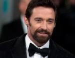 PHOTO: Hugh Jackman poses on the red carpet upon arrival to attend the annual BAFTA British Academy Film Awards at the Royal Opera House in London, Feb. 10, 2013.