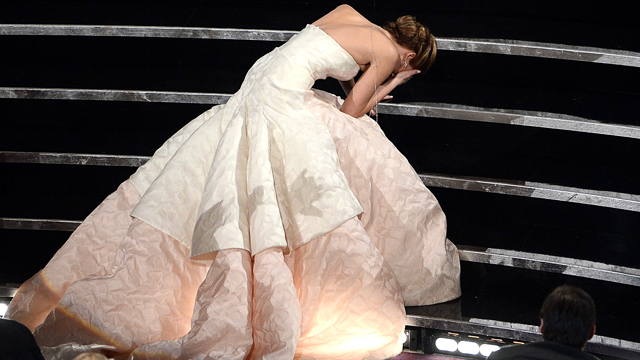 PHOTO: Actress Jennifer Lawrence falls after winning the Best Actress award for &quot;Silver Linings Playbook&quot; during the Oscars held at the Dolby Theatre on Feb. 24, 2013 in Hollywood.