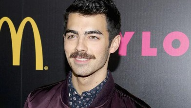 Joe Jonas Rocks a Mustache