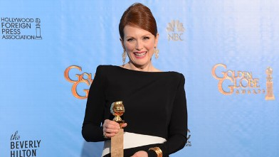 PHOTO: Julianne Moore poses with her Best performance by an actress in a mini-series or motion picture made for television award for &quot;Game Change&quot; in the press room at the Golden Globes awards ceremony in Beverly Hills, January 13, 2013.