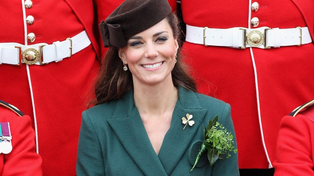 PHOTO: Catherine, the Duchess of Cambridge poses for an official photograph flanked by members of the Irish guards as she visits Aldershot Barracks on St Patrick's Day in Aldershot on March 17, 2012.