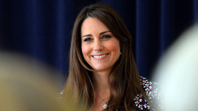 PHOTO: Catherine, Duchess of Cambridge smiles during her visit to The Willows Primary School, Wythenshawe to launch a new school counseling program on April 23, 2013, in Manchester, England.
