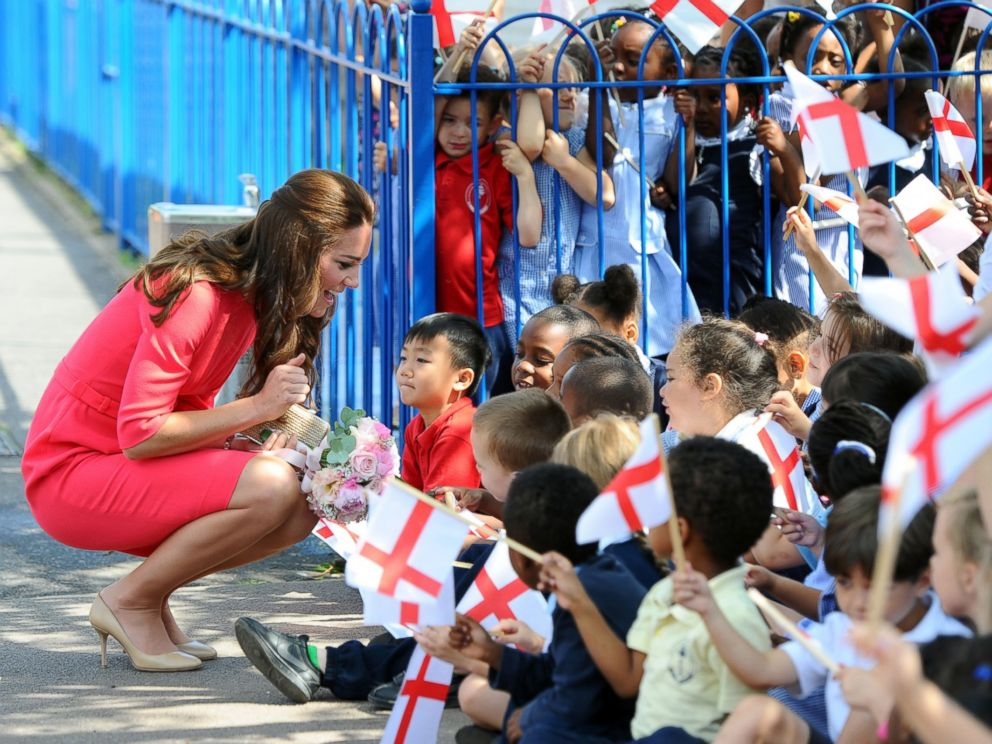 PHOTO: Catherine, Duchess of Cambridge waves as she visits an M-PACT Plus program at Blessed Sacrament School on July 1, 2014 in London, England.