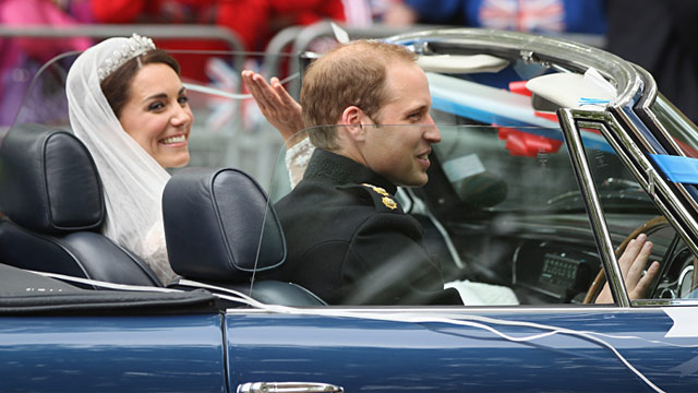PHOTO: Britain's Prince William drives his wife Kate, Duchess of Cambridge, away from Buckingham Palace in a vintage Aston Martin Volante convertible after their wedding at London's Westminster Abbey, April, 29, 2011.