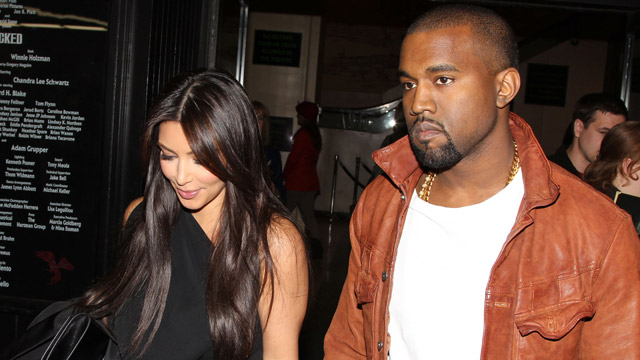 "PHOTO: Kim Kardashian and Kanye West exit from seeing ""Wicked"""