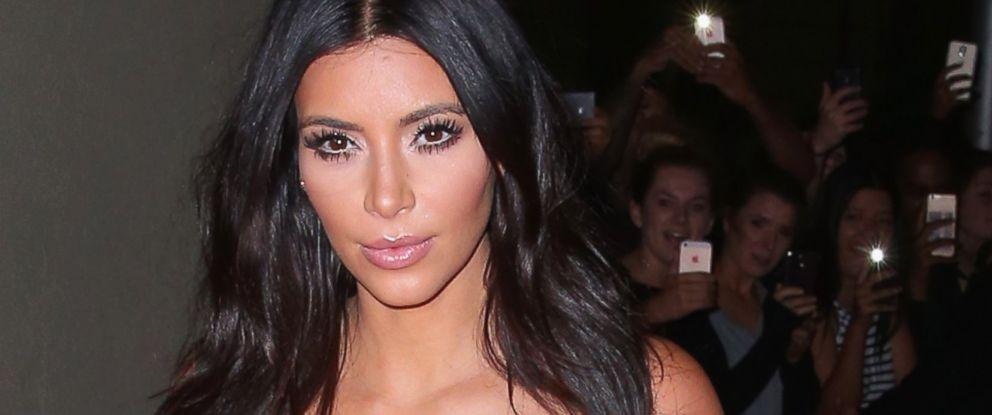 PHOTO: Kim Kardashian arrives to promote her new fragrance at an event in Melbourne, Australia on Nov. 18, 2014.