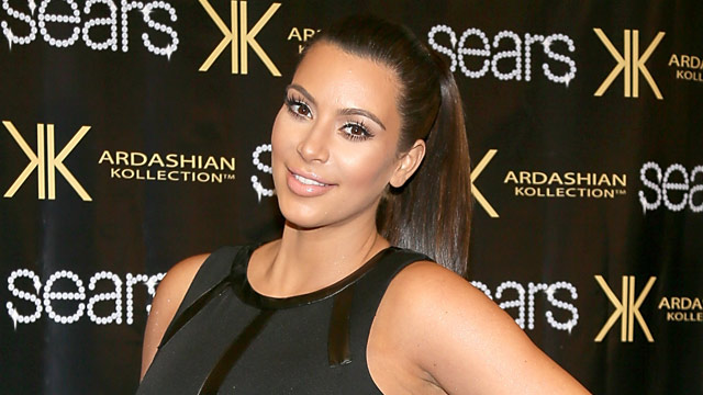 PHOTO: Kim Kardashian poses on the red carpet at Sears to promote t