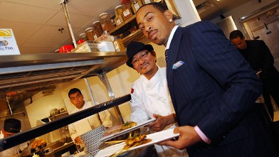 "PHOTO: Chef Chris Yeo and Ludacris show some food from his Grand Opening Restaurant ""Straits"" in the back kitchen of Straits in this April 24, 2008 file photo in Atlanta, Georgia."
