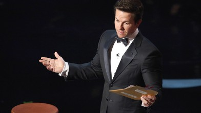 PHOTO: Actor Mark Wahlberg speaks onstage during the Oscars held at the Dolby Theatre, Feb. 24, 2013 in Hollywood.