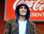 PHOTO: Max George of Chart-topping boy band The Wanted performs at the London 2012 Olympic Torch Relay Special City Celebration at Canon Hill Park Birmingham, presented by Coca-Cola at Cannon Hill Park on June 30, 2012 in Birmingham, England.