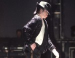 PHOTO: Michael Jackson moonwalks while performing on stage on his HIStory tour in December 1996.