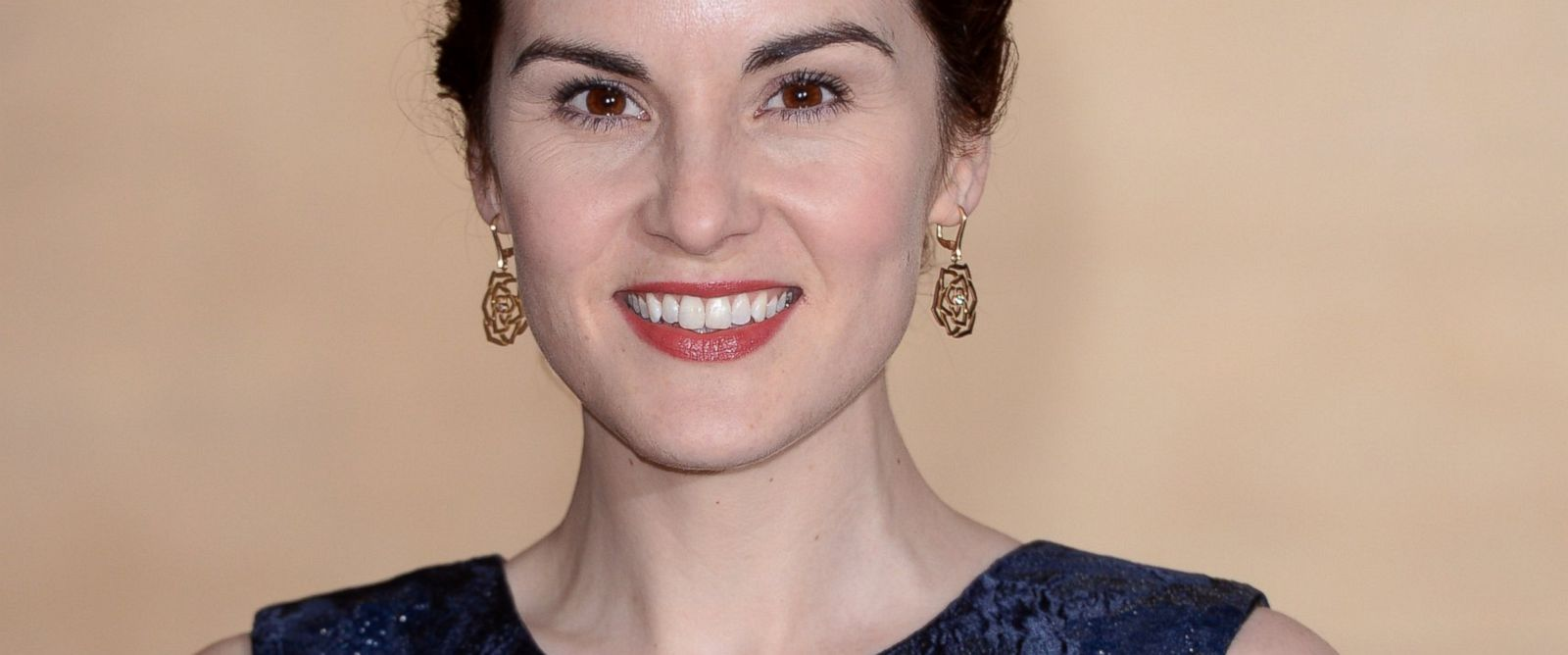 PHOTO: Michelle Dockery attends the Changing Faces Gala Dinner held at Bloomsbury Ballroom on March 27, 2014 in London, England.