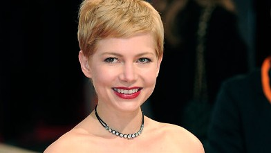 PHOTO: Michelle Williams poses on the red carpet arriving at the BAFTA British Academy Film Awards at the Royal Opera House in London on Feb. 12, 2012.